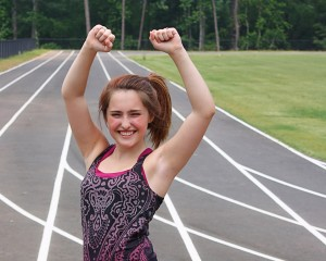 14635-a-cute-young-girl-on-a-track-field-pv